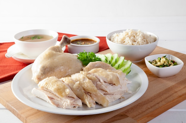 Hainanese chicken rice , steamed chicken with rice, khao mun kai on wood background