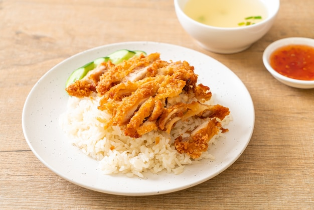 Hainanese chicken rice with fried chicken or rice steamed chicken soup with fried chicken - asian food style