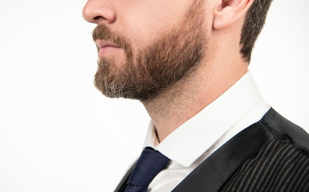 Hair and beard care. formal businessman isolated on white. confident and handsome guy with moustache. male fashion. mens beauty. grizzled man profile. croped elegant man with beard.