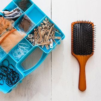 Hair brush and box with hairdressing supplies
