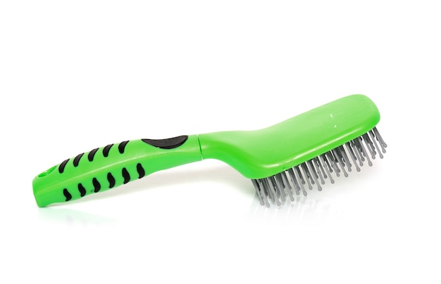Hair brush for horse in front of white