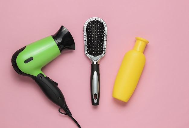Hair care beauty studio shot hair dryer bottle shampoo comb
