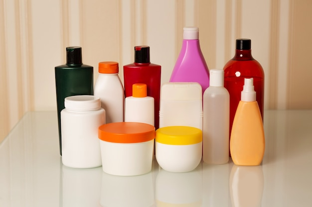 Hair care products: shampoo, conditioner, mask, oil and serum on a beige background