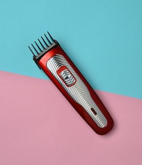 A hair clipper. minimalist trend. top view.