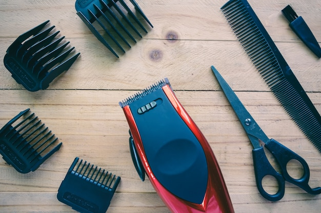 Hair clipper set on wood background