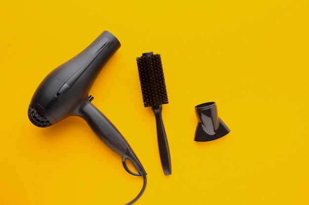 Hair dryer and comb copy space