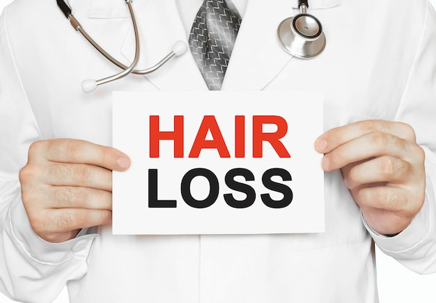 Hair loss card in hands of medical doctor
