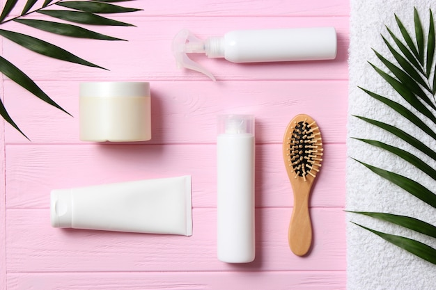Hair products and comb on a colored background close up