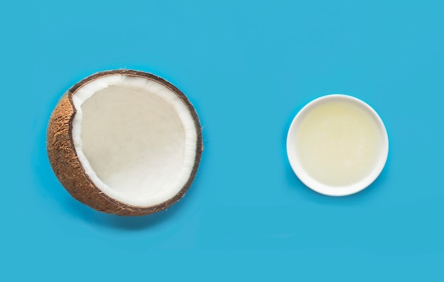 Hair, skin, face, body care. coconut cosmetic products: coconut fresh oil, cream for dry or tanned skin. natural organic cosmetics. beauty, health of face and hair. flat lay.top view