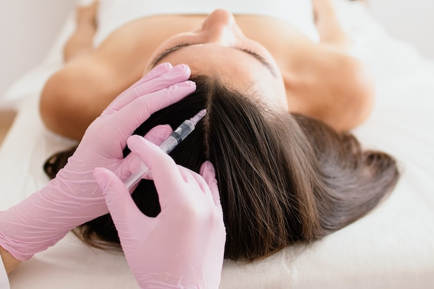 Hair treatment in cosmetology using mesotherapy injection to the head
