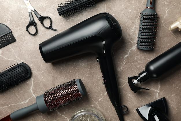 Hairdresser accessories on gray