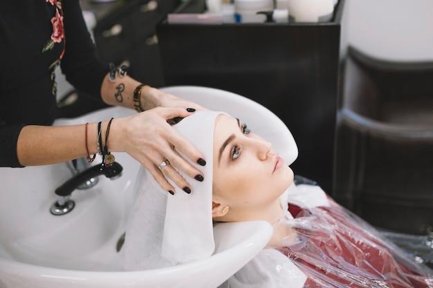 Hairdresser finishing hair wash