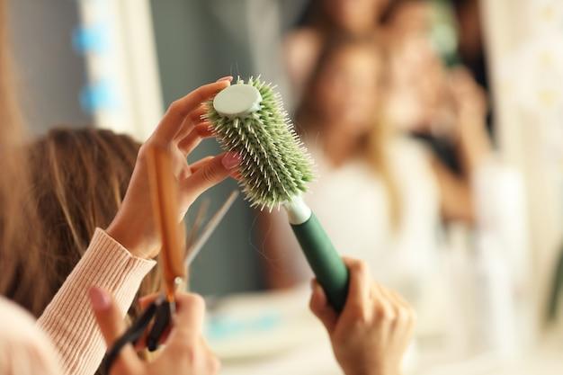 Hairdresser holding hair brush