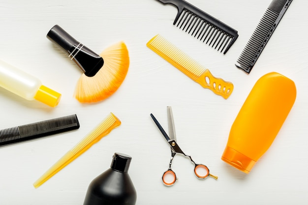 Hairdresser tools, hair salon equipment for professional hairdressing in beauty salon, haircut service. top view flat lay on white background.