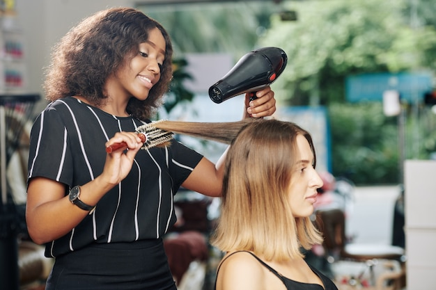 Hairdresser working in beauty salon
