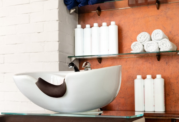 Hairdressing bowl in beauty salon interior