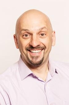 Hairless man smiling