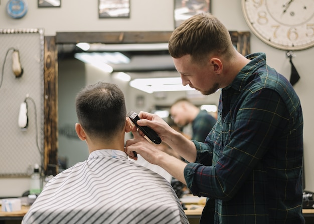 Hairstylist giving a haircut to a client