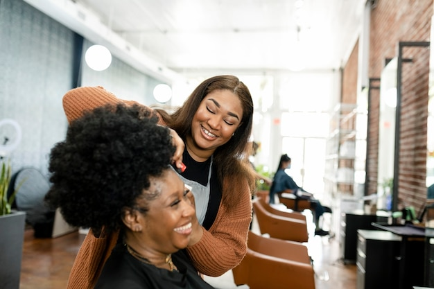 Hairstylist trimming the customer's hair at a beauty salon