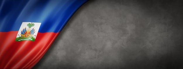 Haiti flag on concrete wall. horizontal panoramic banner. 3d illustration