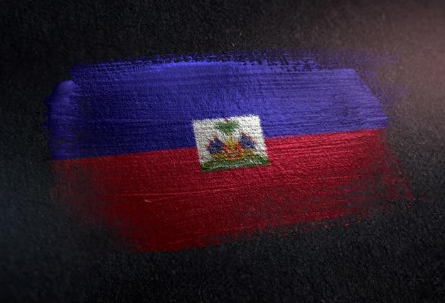 Haiti flag made of metallic brush paint on grunge dark wall