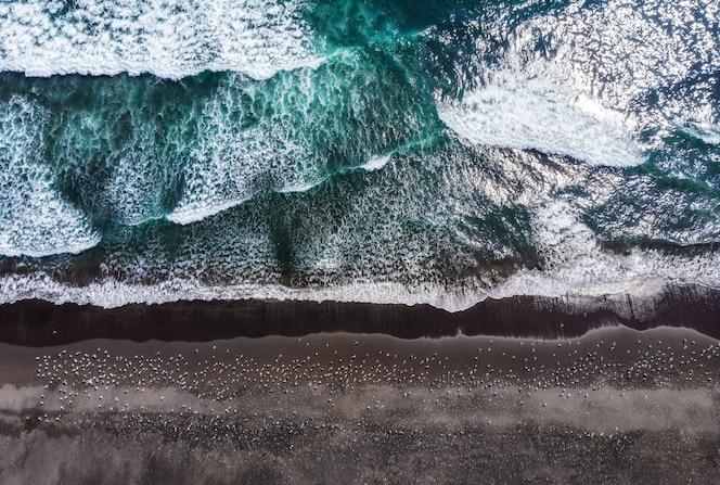 Halaktyr beach. kamchatka. russian federation. dark almost black color sand beach of pacific ocean.