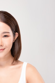 Half of beautiful asian woman looking smile with clean and fresh skin happiness and cheerful with positive emotional