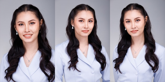 Half body portrait of 20s asian beautiful tanned skin woman black hair wear pastel blue formal dress. office female express feeling smile happy confident at work many poses over gray background