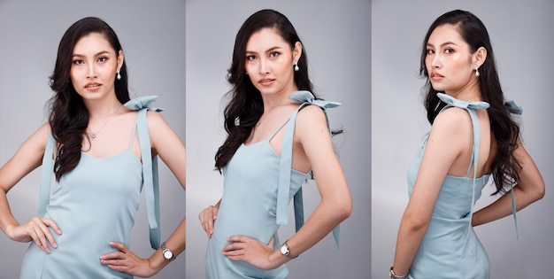 Half body portrait of 20s asian beautiful tanned skin woman black hair wear pastel green formal dress. office female express feeling smile happy confident at work many poses over gray background
