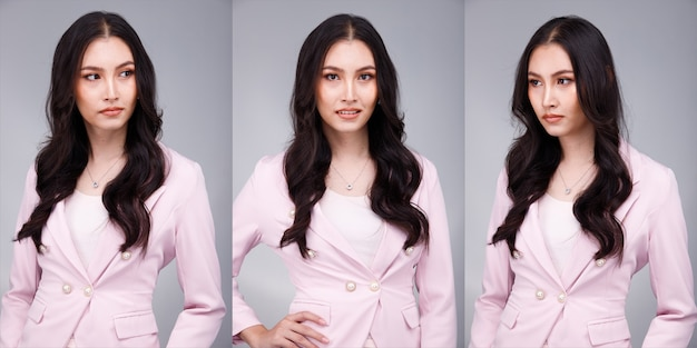 Half body portrait of 20s asian beautiful tanned skin woman black hair wear pastel pink formal dress. office female express feeling smile happy confident at work many poses over gray background