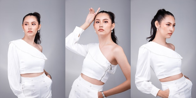 Half body portrait of 20s asian beautiful tanned skin woman black hair wear white formal dress. office female express feeling smile happy confident at work many poses over gray background