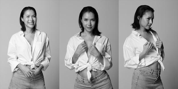 Half body portrait of 40s asian lgbtqia+ woman black hair white vast short jean pant. transgender 30s female express feeling happy smile many poses over white background isolated