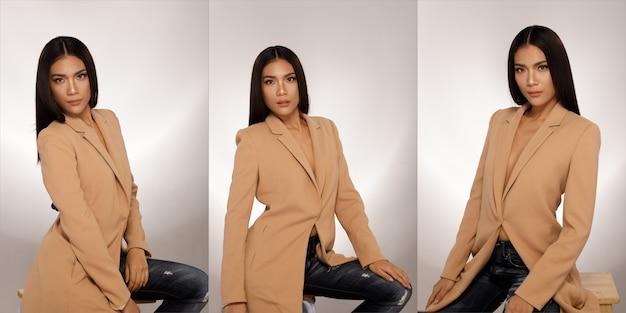 20대 아시아 태닝된 피부의 반신 초상화 검은색 긴 생머리는 갈색 재킷 브라저 양복을 입는다. 사무실 소녀는 흰색 배경 위에 절연 표현 미소 행복 강한 많은 포즈에 앉아