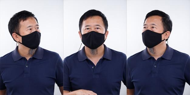50年代のアジア人男性の半身の肖像画ストレート黒髪はフォーマルなポロシャツを着ています。年配の男性は、covidから保護フェイスマスクを置き、白い背景の上にポーズを分離しました