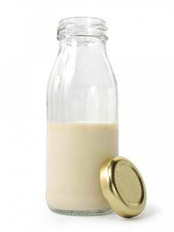 Half bottle of milk with golden cap isolated on white background