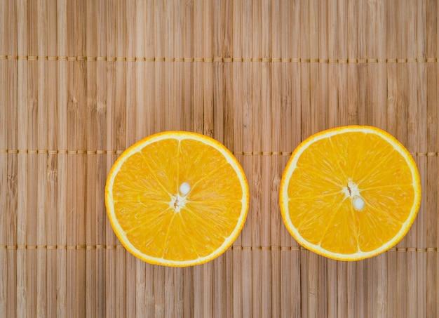 Half cut orange texture on wooden table.