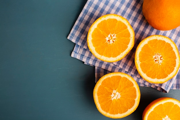 Half cut oranges on table with copy-space
