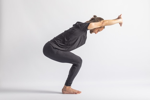 Half fierce or chair pose yoga posture asana