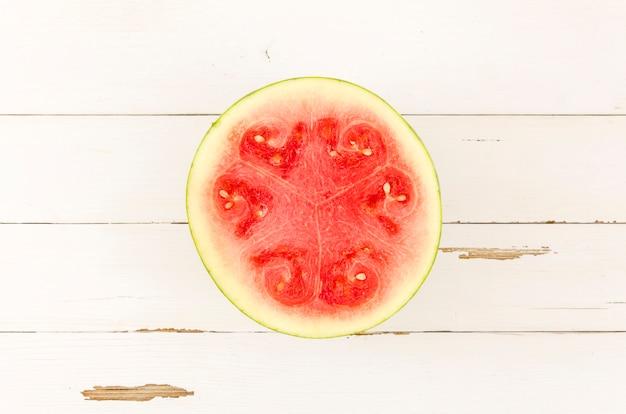 Half of fresh watermelon on table