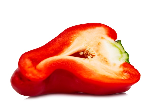 Half a juicy red bell pepper. healthy eating and vegetarianism. close-up. isolated on a white background.