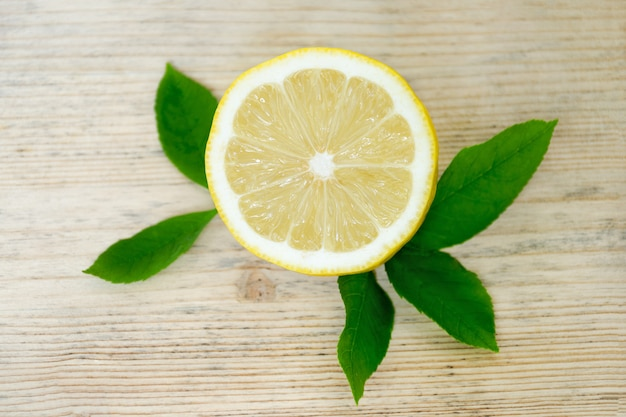 Half a lemon with leaves