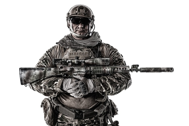 Half length cropped portrait of big muscular soldier in field uniforms with sniper rifle, portrait isolated on white