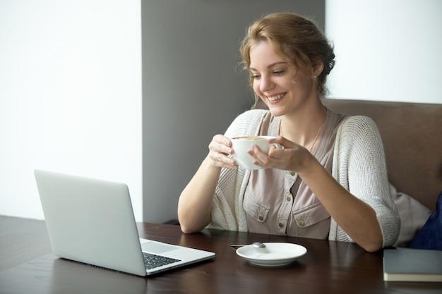 Half-length portrait of business woman on coffee break in cafe