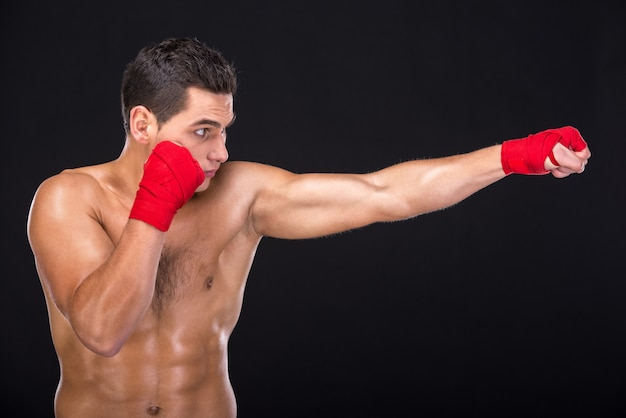Half-length portrait of young nude boxer.