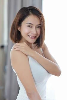 Half length young adult asian woman