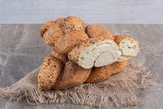 Half-loaves of strucia bread marble background. high quality photo