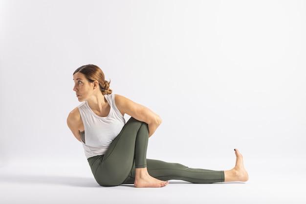 Half lord of the fishes pose yoga posture asana