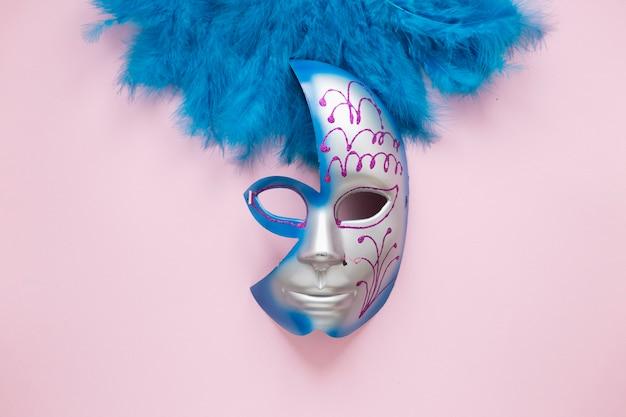 Half mask on blue feathers