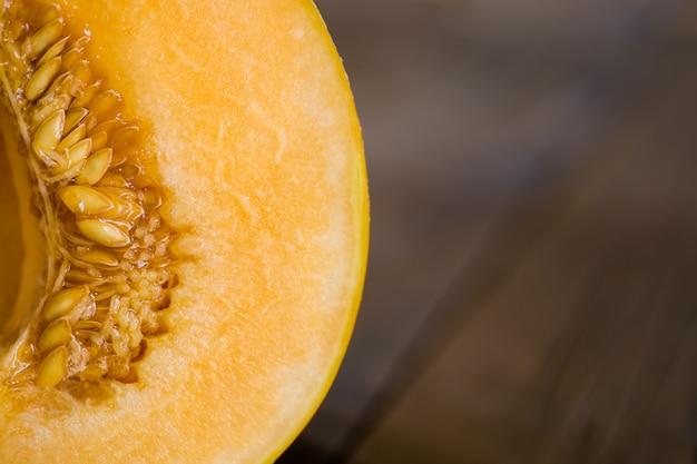 Half melon on a dark wooden background