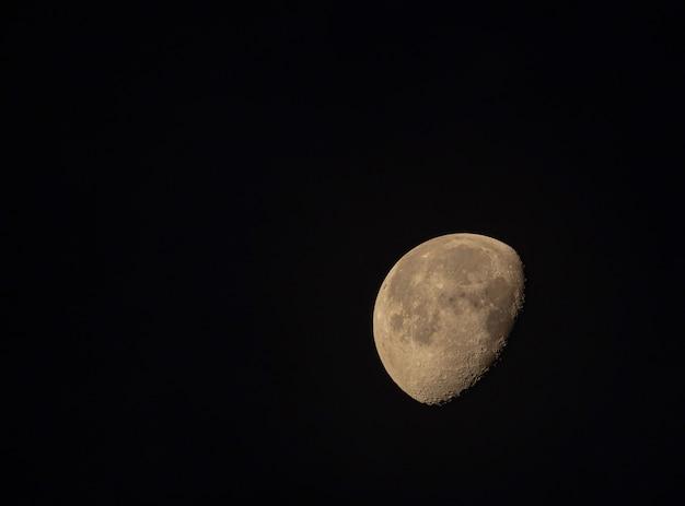 Half moon in black sky